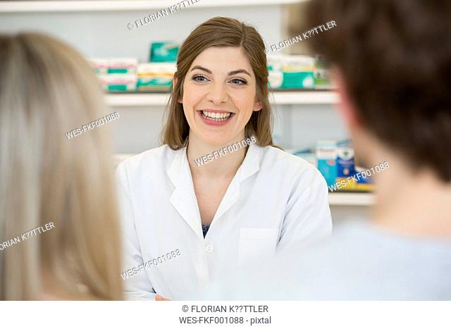 Portrait of smiling female pharmacist advising customers