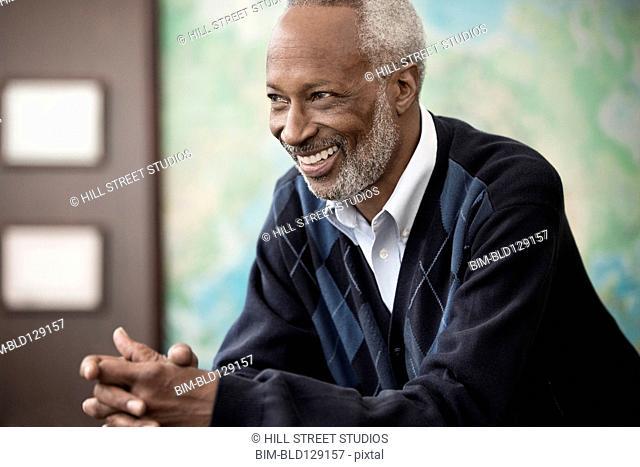 Black professor smiling in classroom