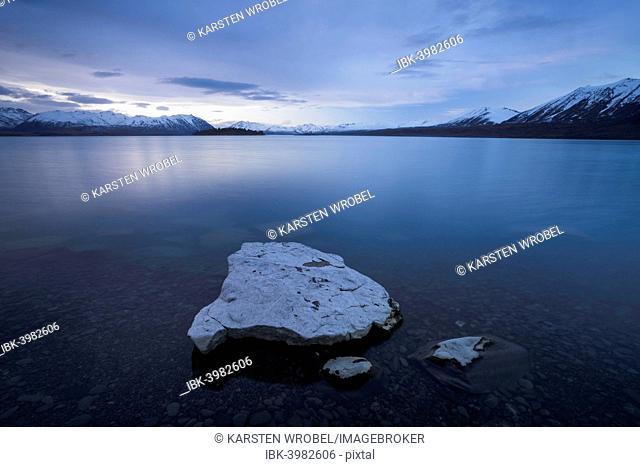 Blue Hour, dusk, at Lake Tekapo in front of mountain range, Canterbury Region, South Island, New Zealand