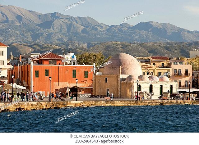 Hassan Pasha Mosque at the Venetian harbor near the sea, Chania, Crete, Greek Islands; Greece, Europe