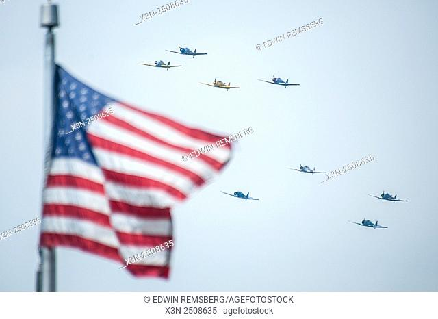 Airplanes flying over the American flag