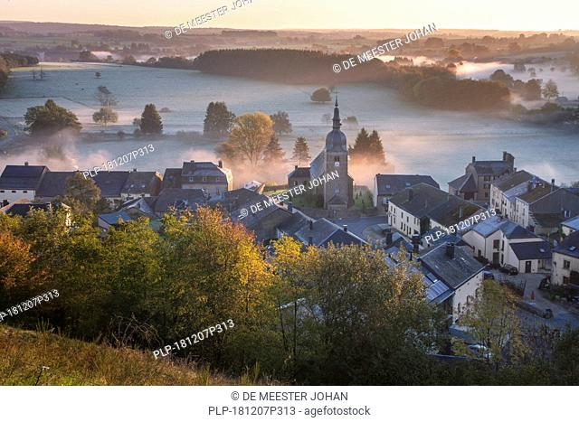 View over the village Chassepierre and frost covered meadows in autumn at dawn, Florenville, Luxembourg, Belgian Ardennes, Wallonia, Belgium