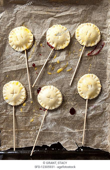 Unbaked Cherry Pie Pops (small cherry pies on the stick)