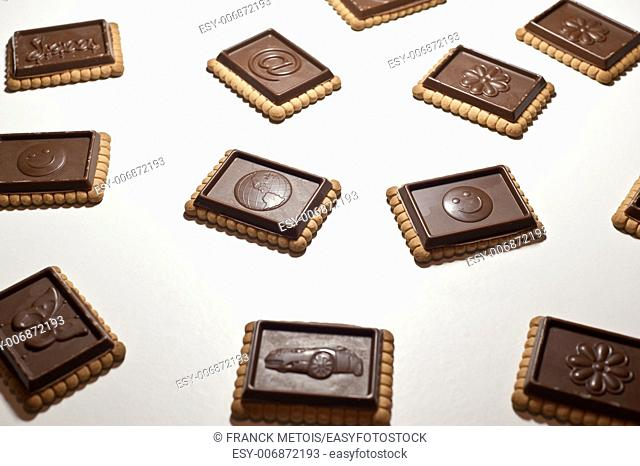 Milk chocolate biscuits on a white background