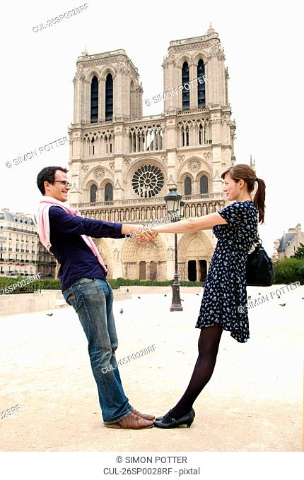Couple in front of Notre Dame Paris