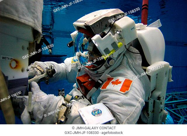 Astronaut Dafydd R. (Dave) Williams, STS-118 mission specialist representing the Canadian Space Agency, wearing a training version of the Extravehicular...