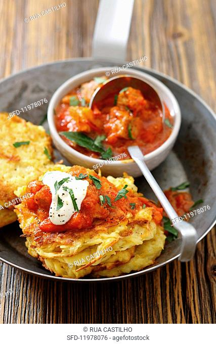 Potato fritters with pork goulash and sour cream