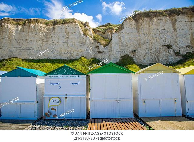 colourful wooden cabins and cliffs at Criel sur Mer in Normandy, France