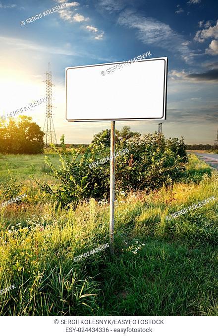 Billboard in a field near the road