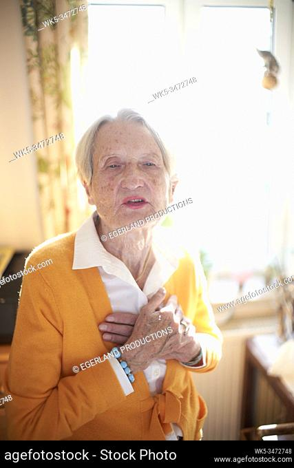 vulnerable senior woman at home, feeling inner world, deep emotions of her past life
