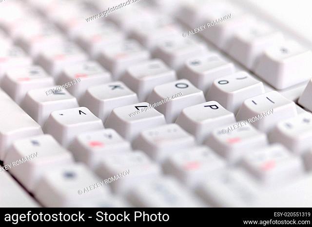 Gray classical computer keyboard close up