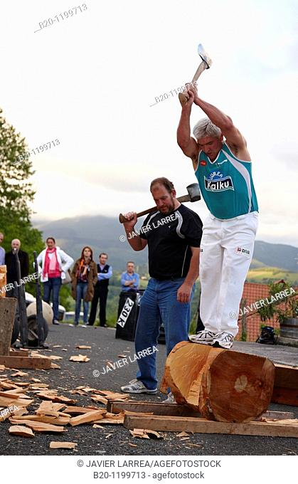 Luis Txapartegi, Aizkolari (wood-chopping), and Iñaki Perurena, Basque rural sport, Aduna, Gipuzkoa, Basque Country, Spain