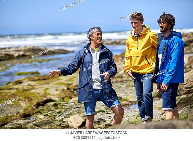 Men by the sea, Route de La Corniche, Cantabrian Sea Coast, Hendaye, Aquitaine, Basque Country, France