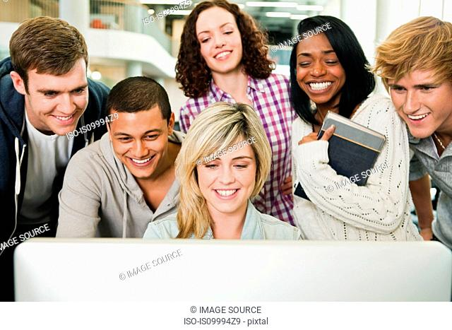 University students watching monitor