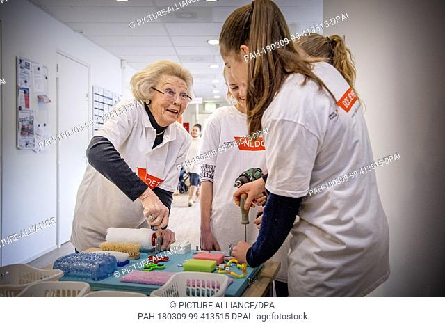 Princess Beatrix of The Netherlands during the annual volunteer day NL Doet at children day care 'Onder een Dak' for children with a handicap in Amersfoort
