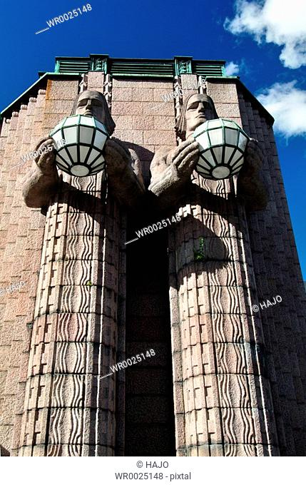 Two statues in front of building
