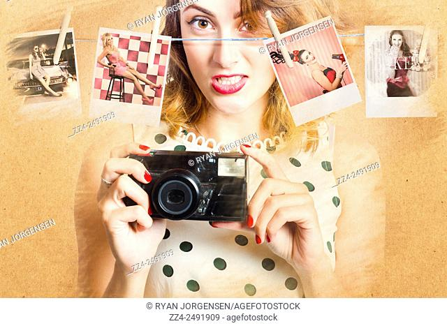 Creative vintage portraiture of a Beautiful 20 year old woman taking artistic retro housewife photographs with old film camera