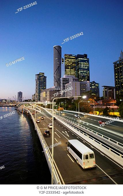 Traffic on Pacific Motorway and Brisbane city skyline, Australia