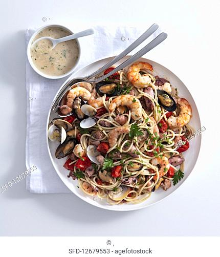 Pasta with seafood and creamy bread sauce