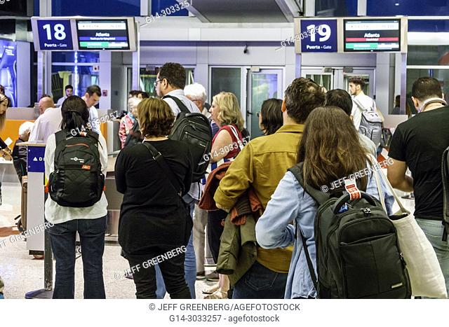 Argentina, Buenos Aires, Ministro Pistarini International Airport Ezeiza EZE, terminal concourse gate area, interior, boarding, line, queue, man, woman