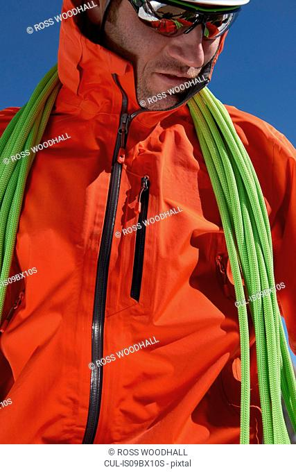Mountaineer with climbing ropes