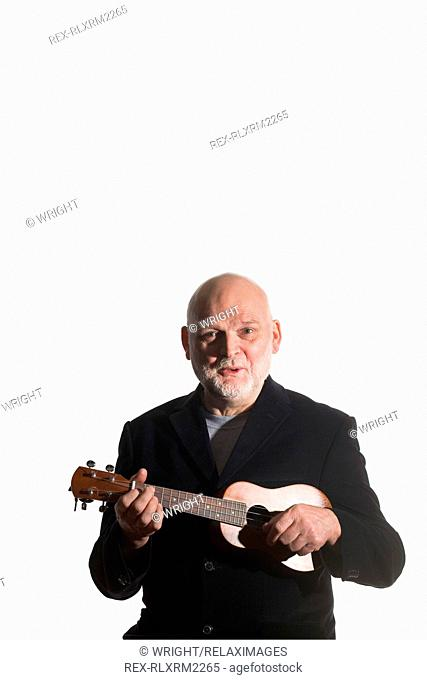 Senior Man playing Ukulele, Munich, Germany