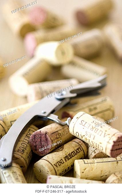 Close-up of corks and a corkscrew