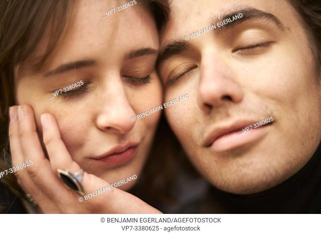 fond couple with closed eyes