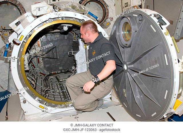 Astronaut Michael Fincke, Expedition 18 commander, is pictured at the open hatch of the Kibo laboratory airlock of the International Space Station