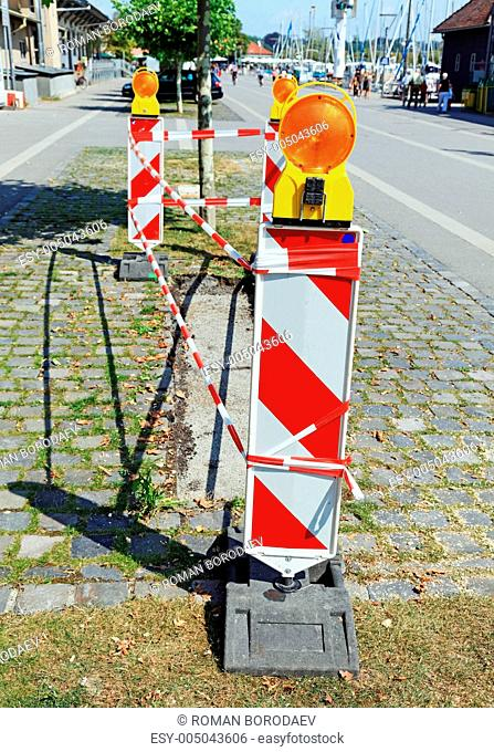 Road signs with flashers informing about some danger during pave