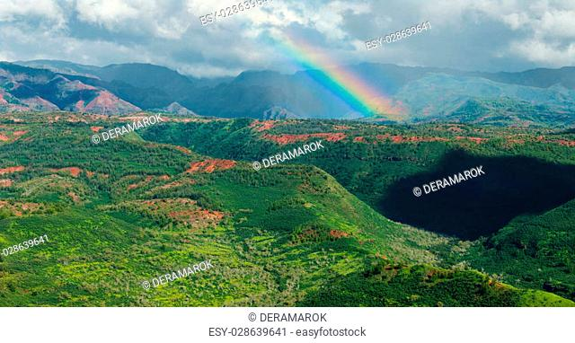 rainbow over waimea canyon area kauai hawaii