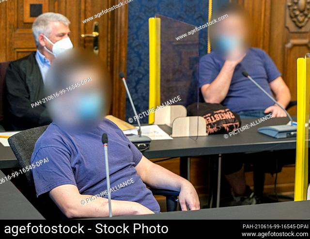 16 June 2021, Mecklenburg-Western Pomerania, Schwerin: The two 25- (back) and 22-year-old defendants sit in the courtroom before the start of the sentencing in...