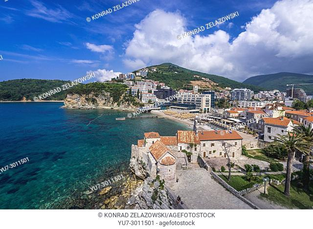 Aerial view with old churches of Saint Sava and Santa Maria in Punta on the Old Town of Budva city on the Adriatic Sea coast in Montenegro