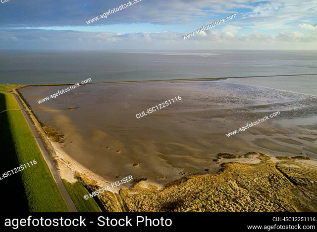 Aerial view of Wadden Sea nature reserve and a dyke in Friesland, The Netherlands