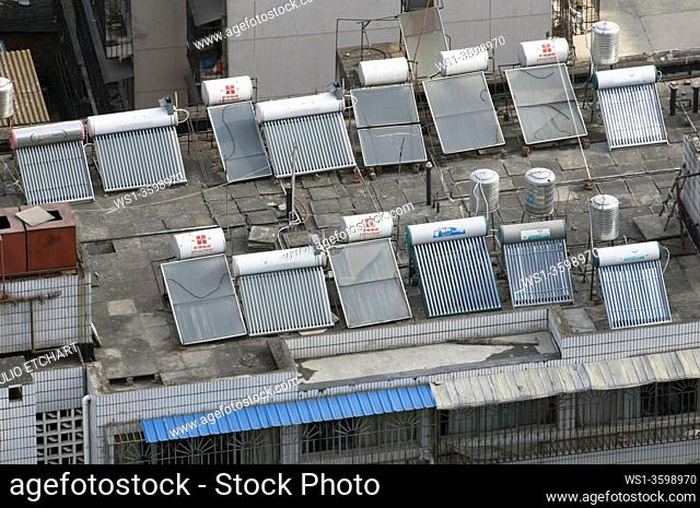 CHINA Solar panels installed on roofs of apartment buildings and offices in Kunming, Yunnan province. Photo by Julio Etchart
