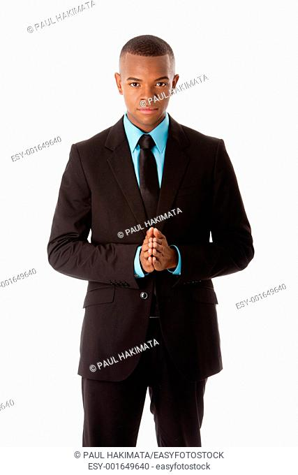 Handsome successful executive corporate business man manager foreman standing with hands together and authoritative expression, isolated