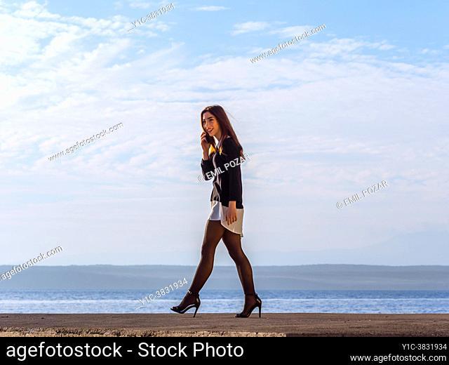 Teenage girl fanciful walking on seaside