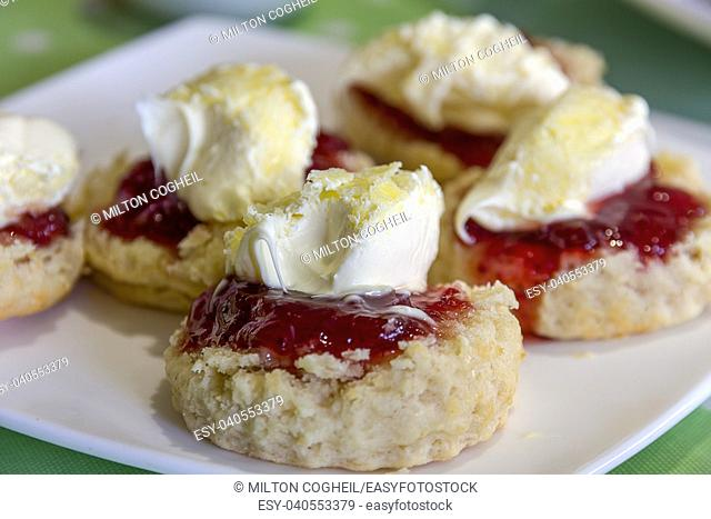 Cornish cream tea scones. Traditionally cream tea scones in Cornwall are served on a Cornish split, a sweet bread roll, with jam then cream on top