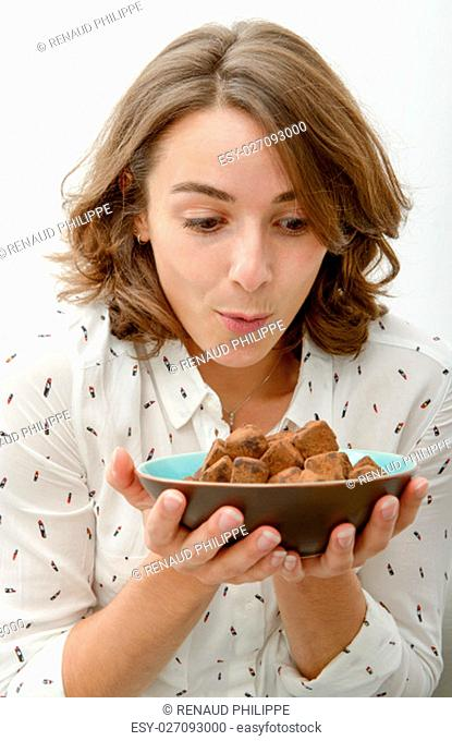 Beautiful young woman woman with a plate of chocolate