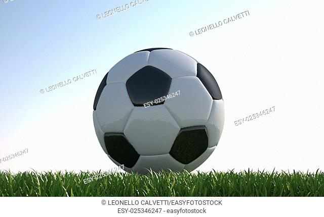 Soccer ball close up on grass lawn. Viewed from ground level. Slightly backlit at nearly sunset lighting. . With light gradient as background