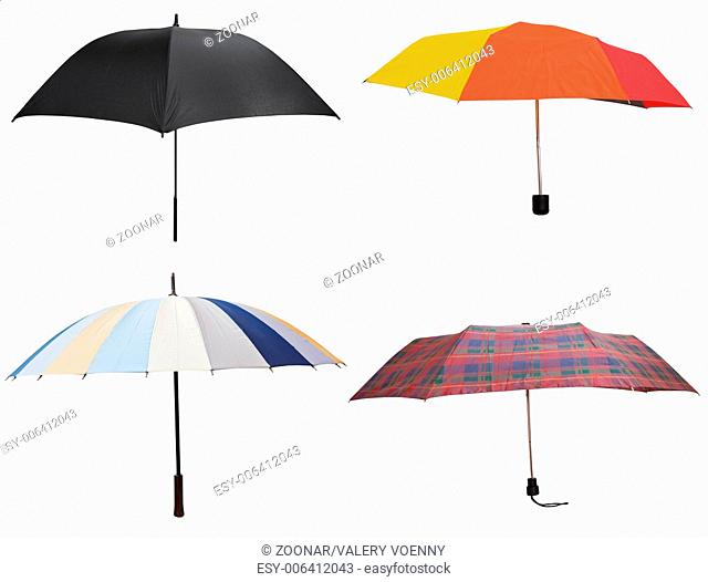 side view of four different open umbrellas