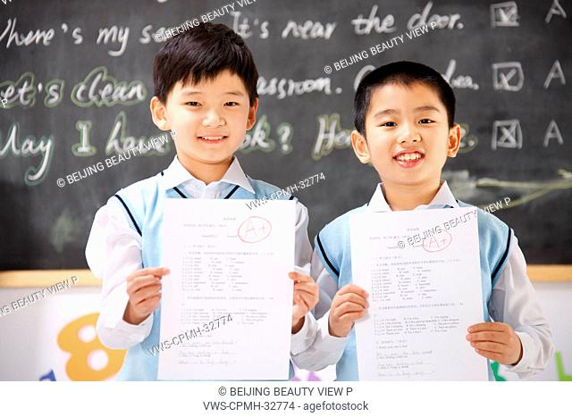 Portrait of two elementary school students in classroom