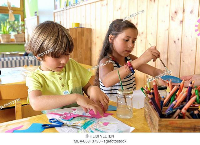 Children doing handdicrafts, portrait