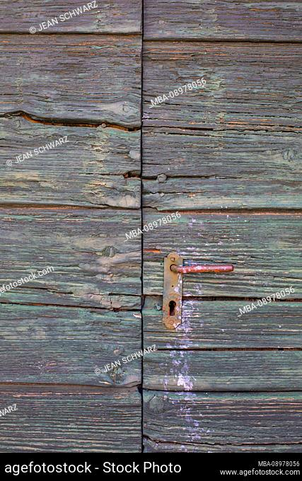 old wooden door in Cres, Croatia