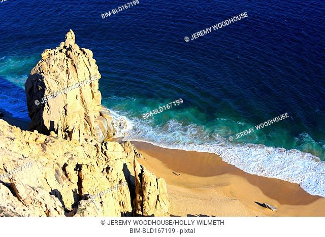 Aerial view of rock formation on sandy beach