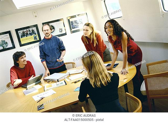 Colleagues having meeting around table