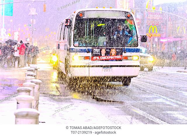 MTA bus, public transportation, mass transit, Times Square during January 2, 2014 winter storm, 42nd Street vicinity, Times Square, Midtown Manhattan
