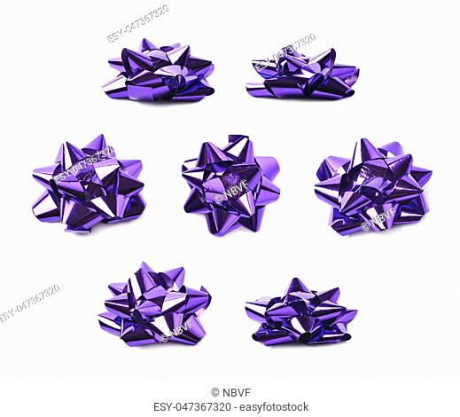 Decorational bow made of glossy violet tape, composition isolated over the white background, set of seven different foreshortenings