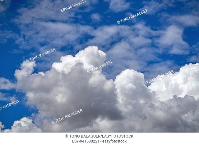 Blue summer sky with cumulus white clouds