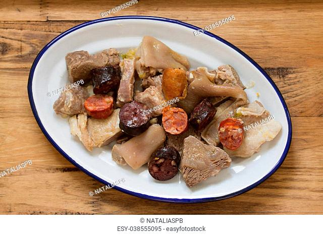 typical portuguese dish on plate on brown background